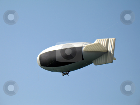 Dirigible advertising media stock photo, A dirigible airship used as a advertising media for your advertisement by Roberto Marinello