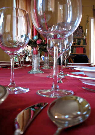 Dinner setting for party stock photo, Dinner setting for a party: cups of wine, cutlery, candles by Roberto Marinello