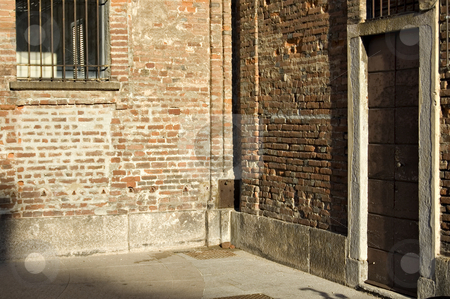 Red brick wall corner stock photo, A corner of an old building made of red bricks by Roberto Marinello