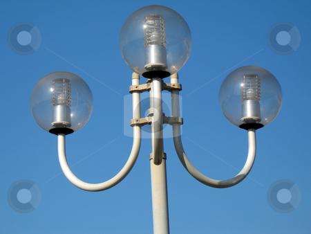 Round streetlamps stock photo, Round streetlamps in the city by Roberto Marinello