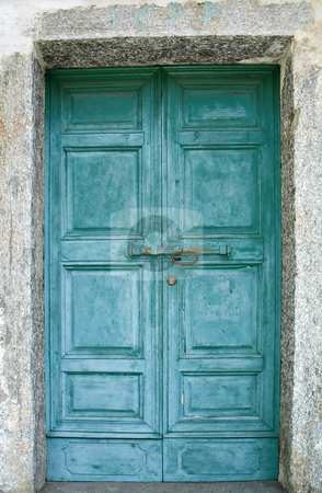 Old green door stock photo, An old green door of a church in a mountain village, Italy by Roberto Marinello