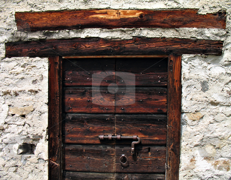 Alpine refuge wooden door stock photo, Old door of a baita (Alpine refuge) in Ossola Valley, Piedmont, Italy by Roberto Marinello