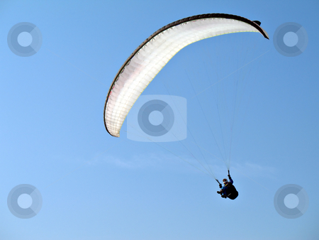 White Paraglide stock photo, A paraglider il flying in the blue sky with his white paraglide by Roberto Marinello