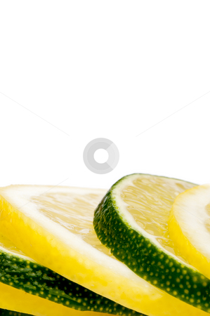 A vertical close-up of a stack of juicy fresh cut lemon and lime stock photo, A vertical close-up of a stack of juicy fresh cut lemon and lime slices with space for copy by Vince Clements