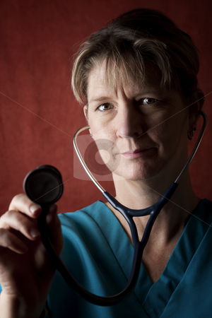 Medical Professional stock photo, Female medical professional in scrubs with stethoscope by Scott Griessel