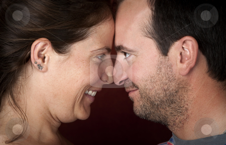 Couple touching noses stock photo, Closeup of pretty woman and handsome man touching noses by Scott Griessel