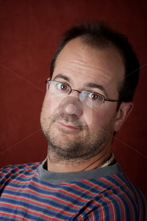 Rugged young man wearing glasses stock photo, Rugged young man with beard stubble wearing glasses by Scott Griessel