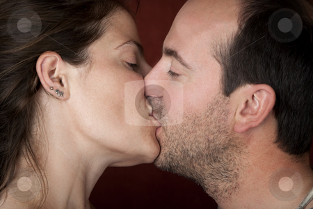 Closeup Kiss stock photo, Closeup of pretty woman and handsome man kissing by Scott Griessel