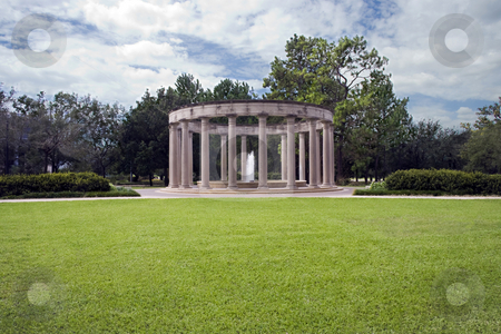 Garden Scene stock photo, A classical monument with a single fountain behind a great lawn by Kevin Tietz