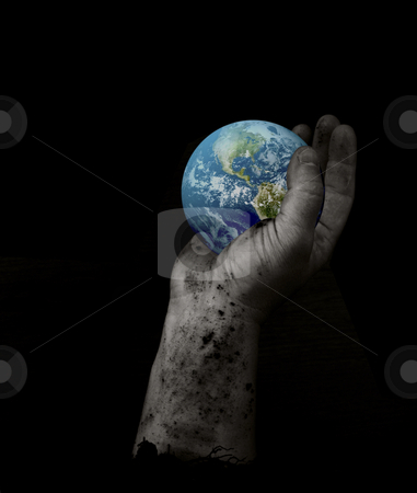 Hand holding earth stock photo, Hand with dirt holding earth with grain by John Teeter