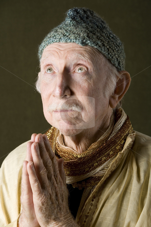 Praying Holy Man stock photo, Guru praying with hands and looking up by Scott Griessel