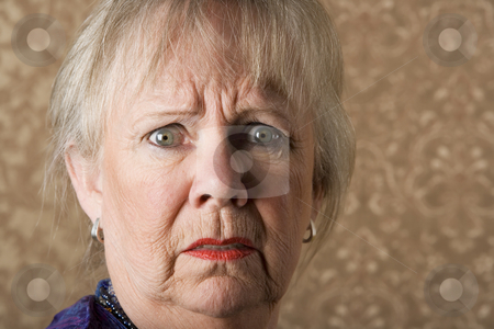 Horrified Senior Woman stock photo, Closeup portrait of horrified senior woman with bright lipstick by Scott Griessel
