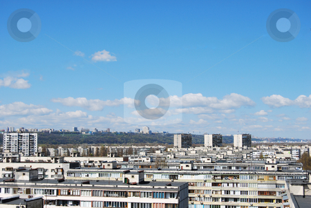 Urban view horizon stock photo, Thousand of roofs against cloud sky background by Leyla Akhundova