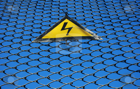 Danger: electricity stock photo, Warning sign against the grating by Leyla Akhundova