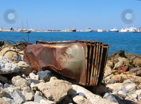 Rusty Tin baths stock photo, Stack of baths rusting on a beach near Kyrenia port, North Cyprus by Helen Shorey