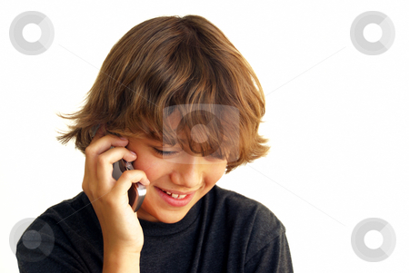 Smiling teenage Boy Talking on Mobile Phone stock photo, Smiling teenage boy talking on mobile phone isolated on white background. by Denis Radovanovic