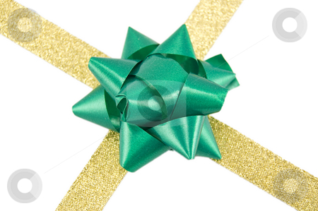 Golden ribbon with green bow stock photo, Christmas decoration golden ribbon with green bow isolated on white by Roberto Marinello