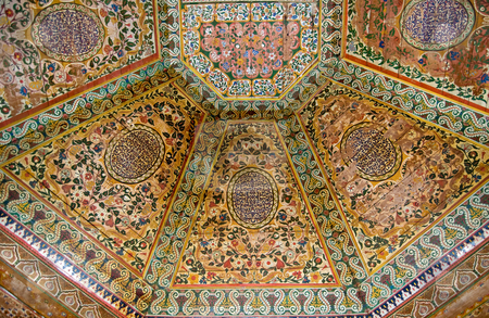 Painted wooden ceiling stock photo, A painted wooden ceiling of the Bahia Palace in Marrakesh, Moroc by Roberto Marinello