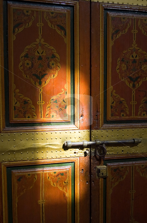 Painted door ligth playing stock photo, A painted door of the Bahia Palace in Marrakesh with light reflection, Moroc by Roberto Marinello