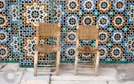 Two chairs on tiles background stock photo, Two chairs and zellij tiles, Ben Youssef Medersa, Marrakesh by Roberto Marinello