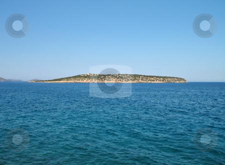 Wild Island stock photo, A wild green island in the sea in a windy day by Roberto Marinello