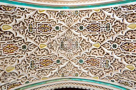 Moroccan style stucco background stock photo, Stucco details of Bahia Palace in Marrakesh, Morocco by Roberto Marinello