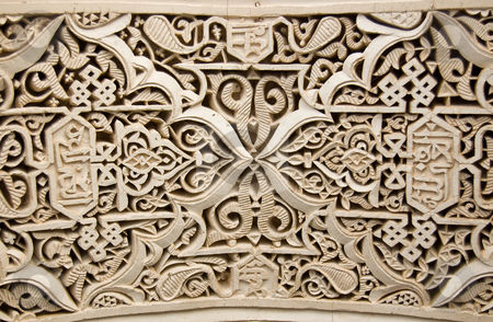 Moorish style stucco background stock photo, A detail of a Moorish style stucco in Marrakesh by Roberto Marinello