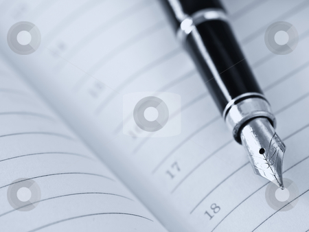 Planning things stock photo, Pen and organizer,blue-toned,shallow DOF by Vladimir Koletic