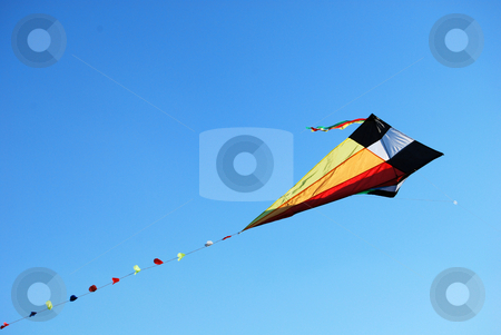 Coloured kite stock photo, Kite of different color flying in the blue sky by Leyla Akhundova