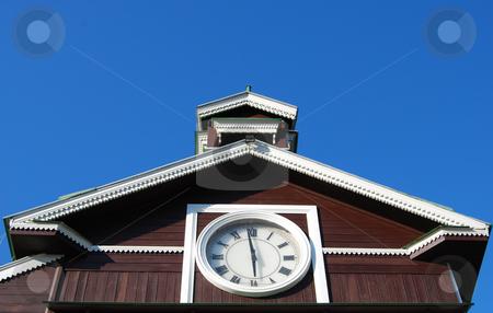 Clock on old wooden bulding stock photo, Roman numerals clock on old wooden chapel by Leyla Akhundova