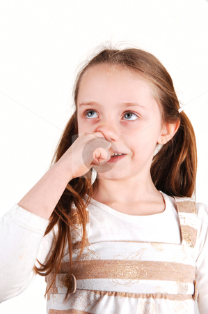 Girl with finger in nose. stock photo, A little girl standing in front of the camera and having her finger in her nose, looking shay to her parents. by Horst Petzold
