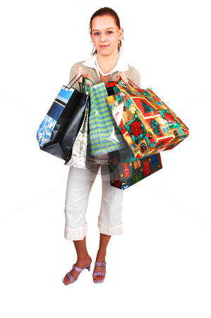 An young shopping woman. stock photo, A young woman back from an shopping spree is happy that she got what she was looking for. by Horst Petzold