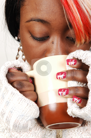 Young Jamaican woman with coffee. stock photo, An pretty woman from Jamaica with nice colored hair having a hot coffee in the winter. by Horst Petzold