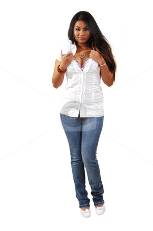 Young Asian girl drinking. stock photo, Young Asian woman holding her drink in front of the camera, in tight jeans and white blouse.. by Horst Petzold