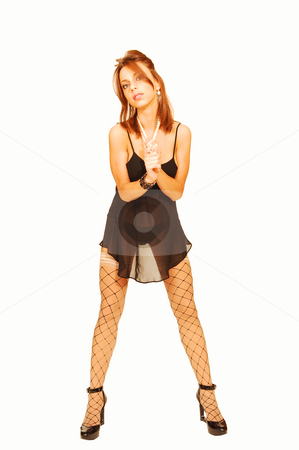 Standing woman in lingerie. stock photo, An very fit woman in black lingerie and fishnet stockings standing in an   studio for white background and shooing her great figure. by Horst Petzold