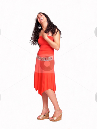 Young girl in red laughing stock photo, An pretty young girl with long dark hair in an nice red dress is standing and smiling on white background. by Horst Petzold