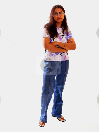 Young indian lady. stock photo, An young indian lady standing in jeans and blouse on white background. by Horst Petzold