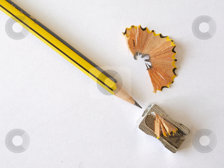 Pencil and a sharpener.  stock photo, Pencil after sharpening with some new shavings. by Ian Langley