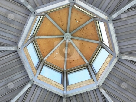 Tower roof    stock photo, The inside of a tower roof with his metal, wood and glass construction. by Horst Petzold