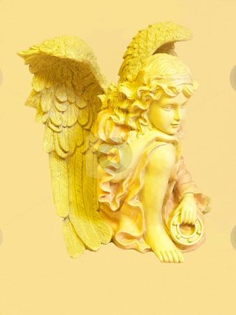 Angel   stock photo, An yellow angel with big wings on light yellow background. by Horst Petzold