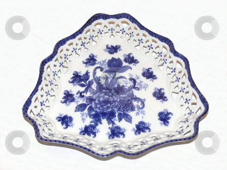 Blue willow   stock photo, An blue willow plate in triangular form made from bone china. by Horst Petzold