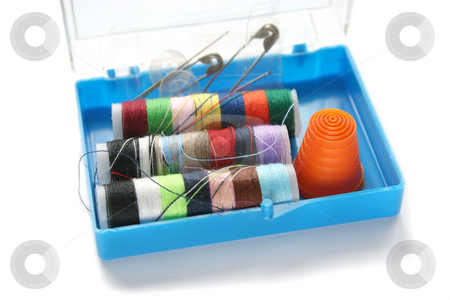 Emergency Sewing Kit stock photo, Little blue plastic box with emergency sewing supplies - needles, pins, threads, thimble and buttons by Helen Shorey