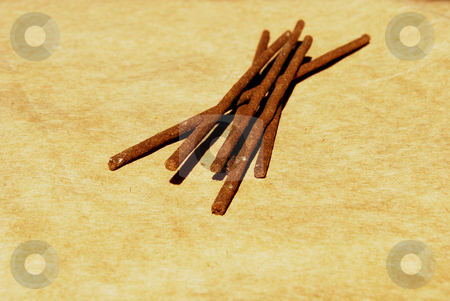 Joss sticks stock photo, Joss sticks close-up on hard paper background by Leyla Akhundova