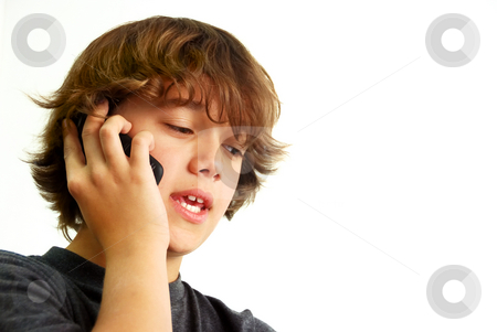 Teenage Boy Talking on Mobile Phone stock photo, Teenage boy talking on mobile phone isolated on white background. by Denis Radovanovic