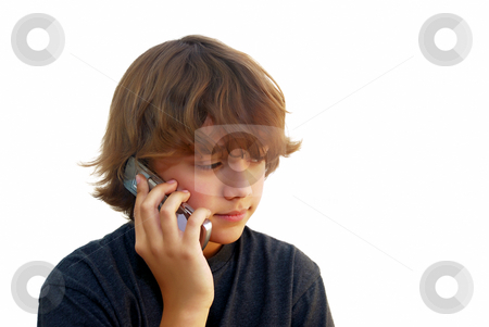 Teen Boy Talking on Mobile Phone stock photo, Teen boy talking on mobile phone isolated on white background. by Denis Radovanovic