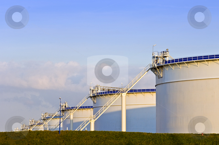 Oil tanks stock photo, Oil tanks in the evening light by Corepics VOF