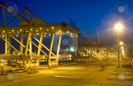 Fully automated container terminal at night stock photo, The fully automated container teminal at Rotterdam Harbor at night, with fully automated trolleys taking the containers to and from the waiting cranes. by Corepics VOF