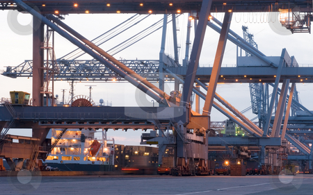Container terminal Cranes stock photo, The huge cranes used to load and unload sea going container ships in Rotterdam harbor by Corepics VOF