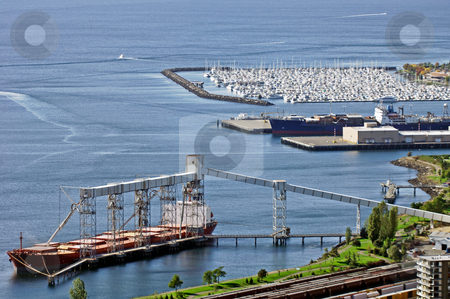 Seattle harbour view stock photo, A vew of Seattle harbor with a huge freighter loading and a marina in the background by Corepics VOF