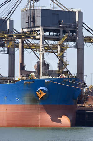 Unloading iron ore stock photo, A huge crane unloading ore from a bulk carrier by Corepics VOF